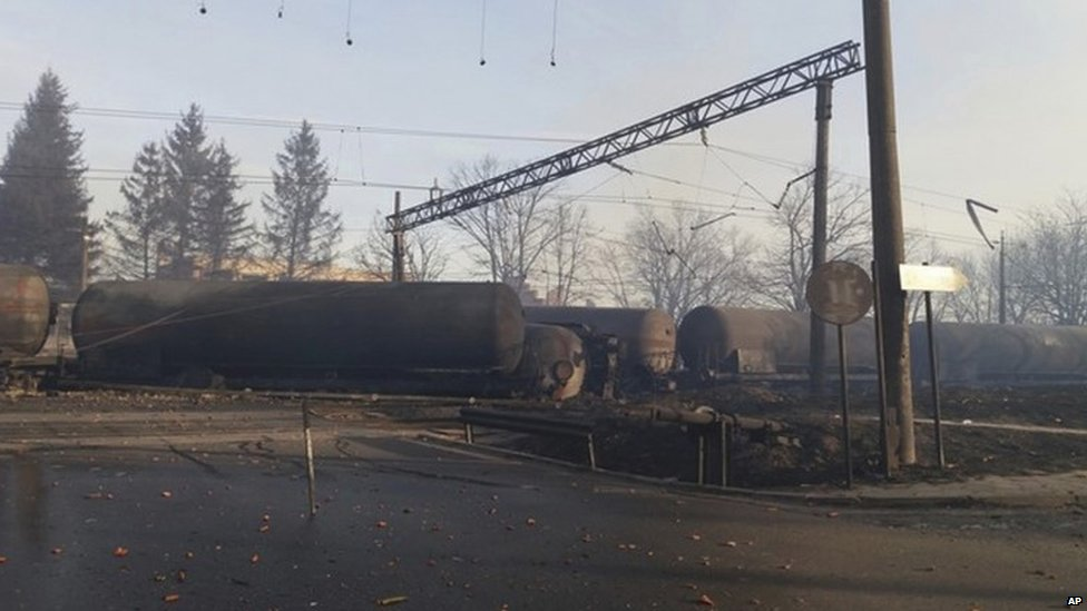 In this photo released by Bulgarian Interior Ministry, burned containers are seen derailed after an explosion upon derailment in the village of Hitrino in Bulgaria Saturday, Dec 10, 2016.