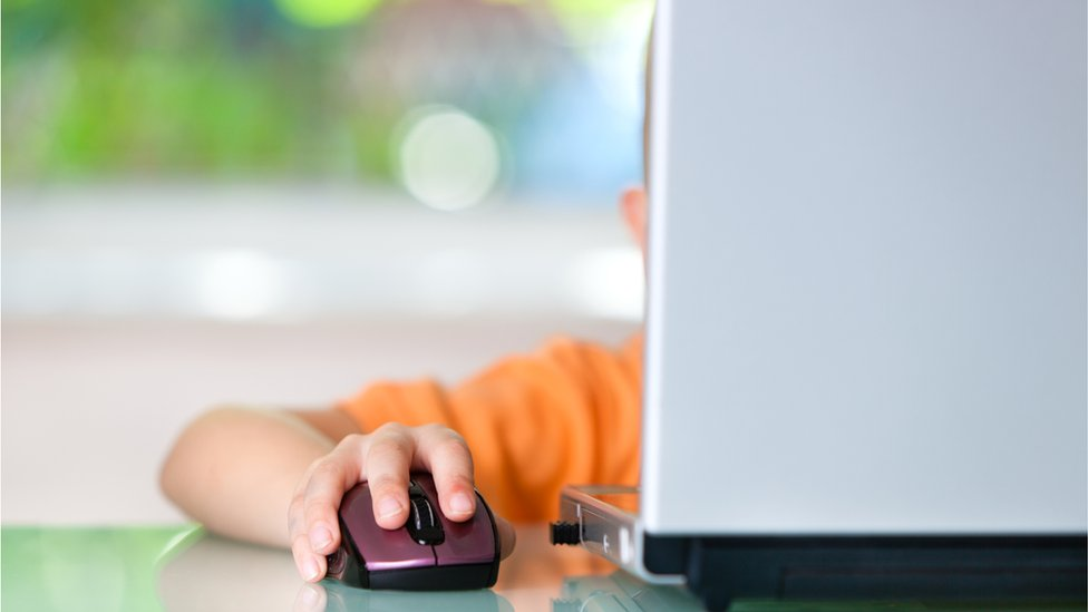 boy clicking on mouse