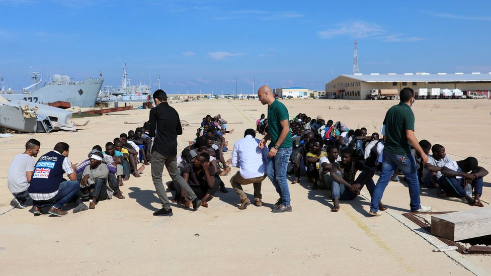 Migrants are checked at a naval base after they were rescued by Libyan coastguard, in Tripoli, Libya