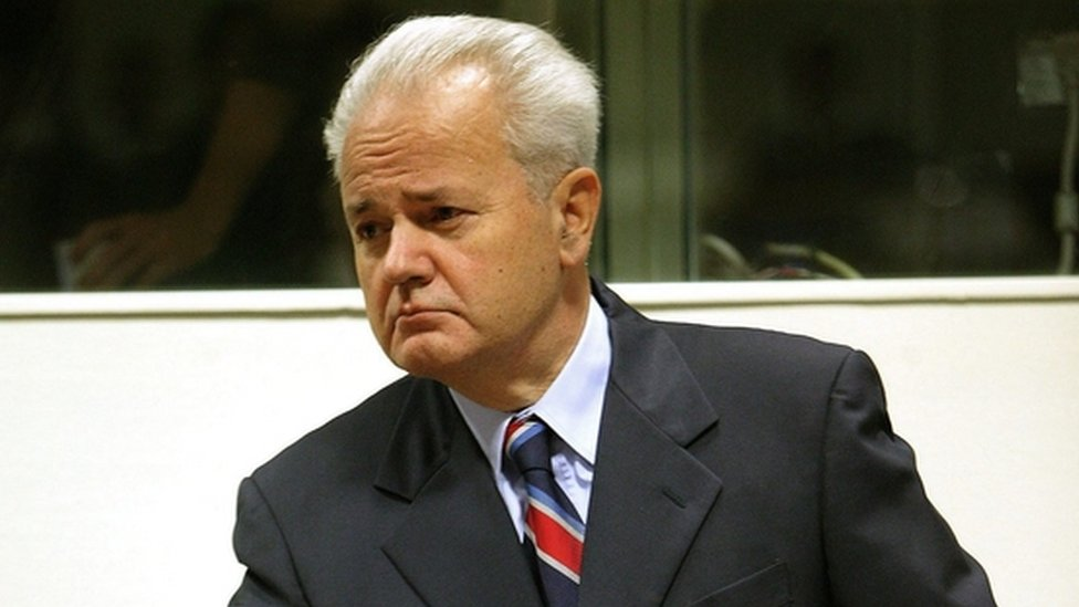 Former Yugoslav President Slobodan Milosevic arrives to open his defence at the war crimes tribunal 31 August 2004 in The Hague, Netherlands
