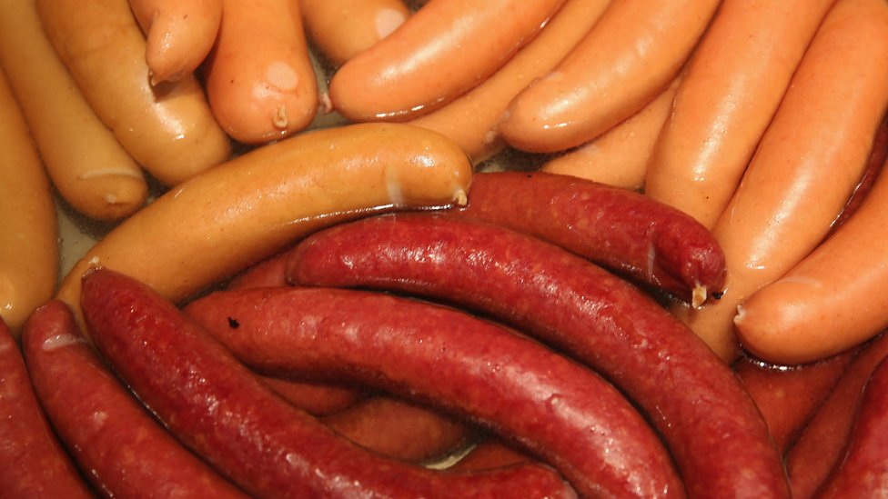 Bockwurst and krakauer sausages simmer in hot water at a stand at the International Green Week agricultural trade fair (Internationale Gruene Woche) on January 16, 2015 in Berlin, Germany.