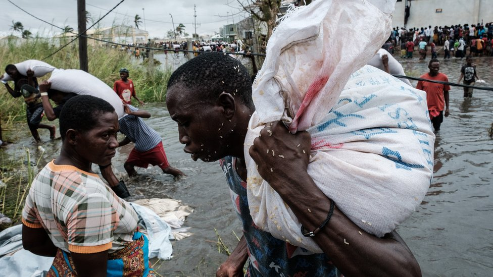 A man in Mozambique carrying rice