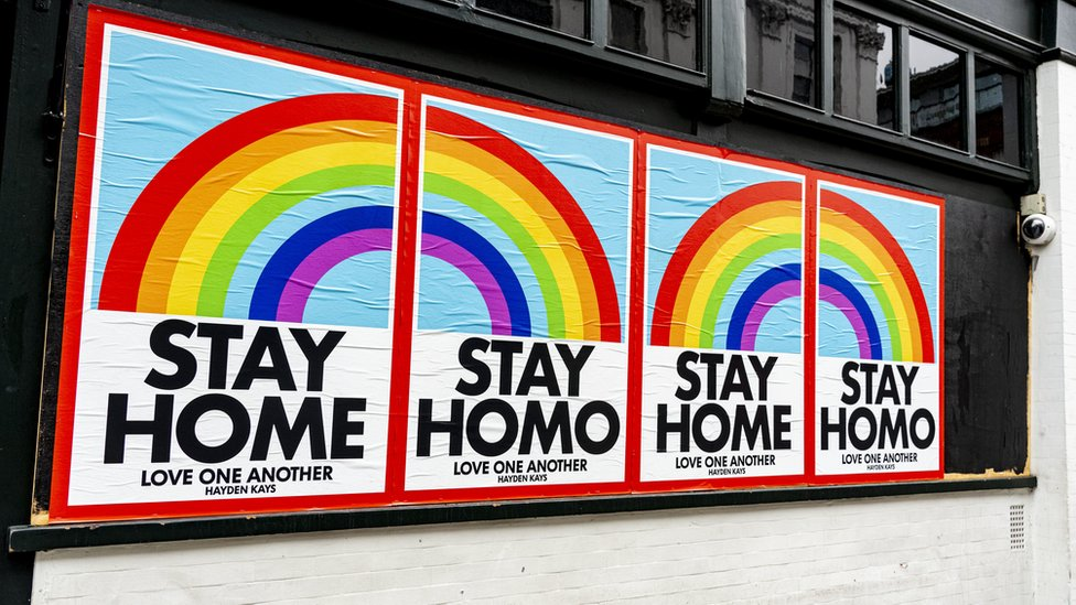 Stay Home sign on a business