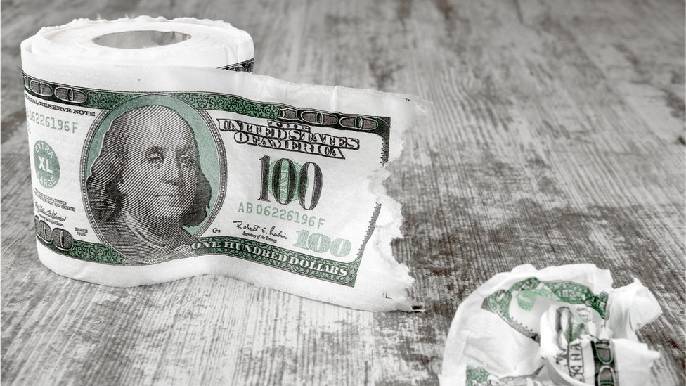 Toilet paper with a print of a $100 note