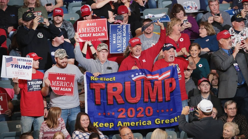 Supporters attend a campaign rally with U.S. President Donald Trump at the Mid-America Center on 9 October 2018 in Council Bluffs. Iowa