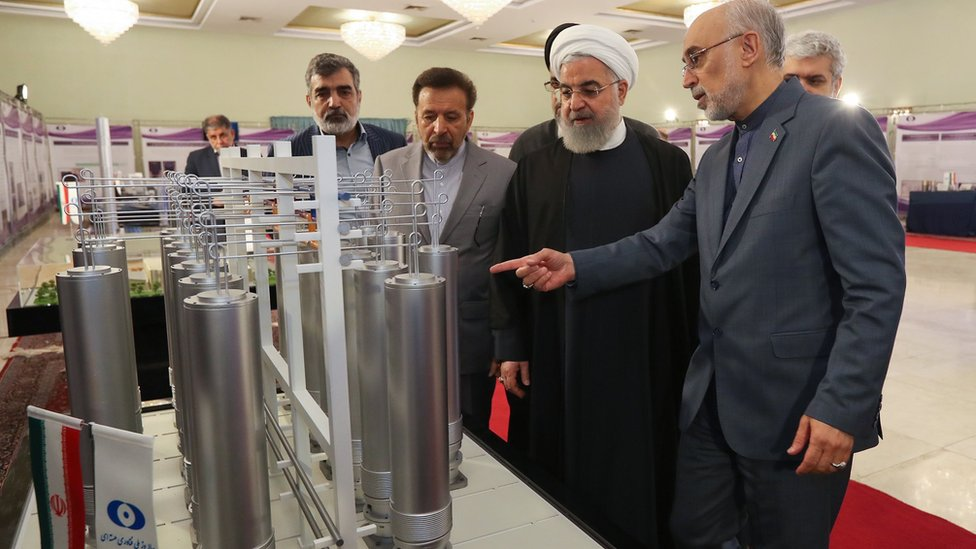 Iranian President Hassan Rouhani is shown nuclear technology by Atomic Energy Organization of Iran chief Ali Akbar Salehi in Tehran on 9 April 2019