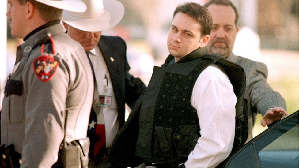In this file photo taken on February 24, 1999 John William King (C) is escorted into the Jasper County Courthouse for the penalty phase of his capital murder trial in Jasper, Texas. - John William King, is set to be executed on April 23, 2019, barring a last-minute stay of execution, for the murder of James Byrd Jr. after he was dragged behind a pickup truck for over 3 miles in June 7, 1998.