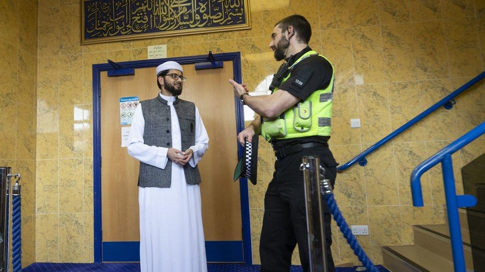 Imam Qari Asim talks to PC Plumber as he visits the Makkah Mosque in Leeds