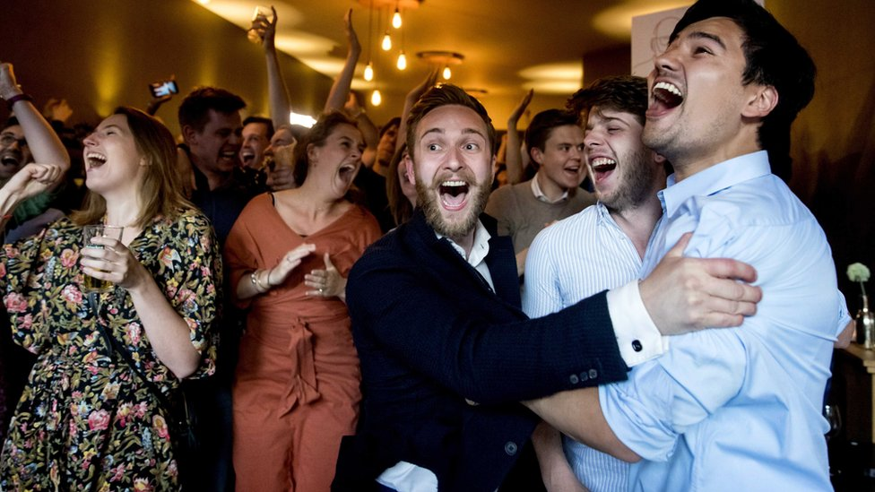 Members of the Labour Party (PvdA) celebrate after the exit polls of the European Parliament elections The Hague,