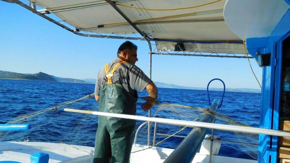 Fisherman off the coast of Greece