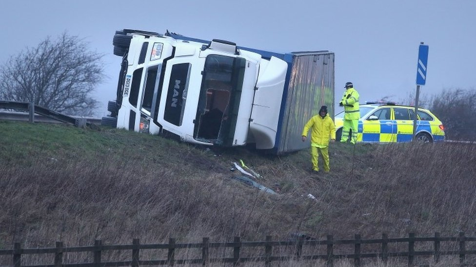 Overturned lorry on the M9