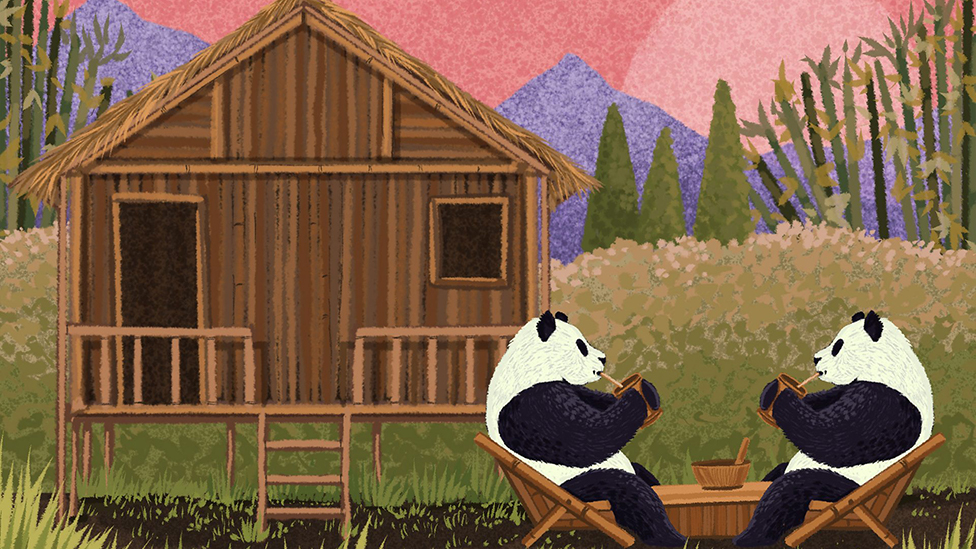 Two pandas having tea with a house made of bamboo in the background