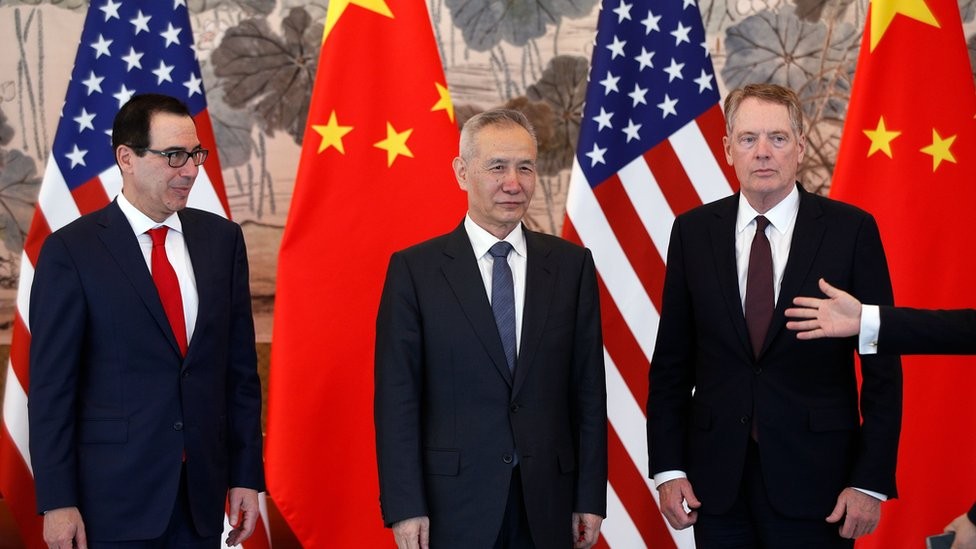 Chinese Vice Premier Liu He (C), US Treasury Secretary Steven Mnuchin (L) and US Trade Representative Robert Lighthizer (R) arrive for a group photo session after concluding their meeting at the Diaoyutai State Guesthouse in Beijing on May 1, 2019.