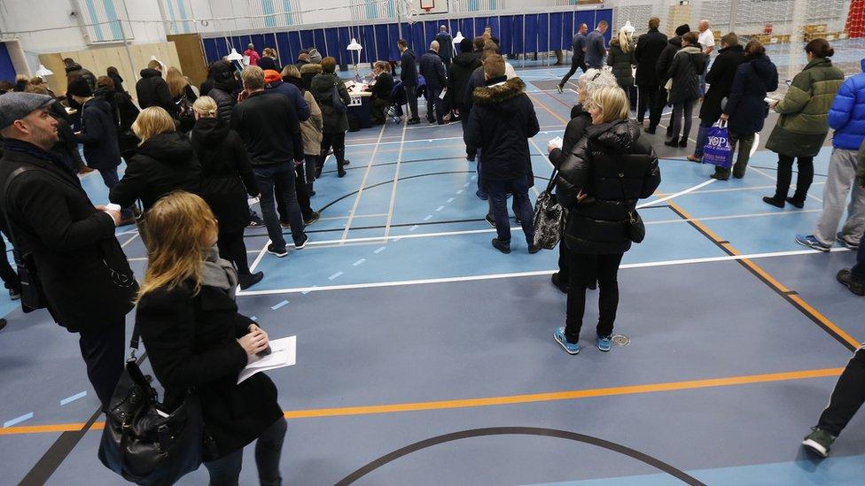 Danish voters queue up at a polling station in a Copenhagen school (3 December)
