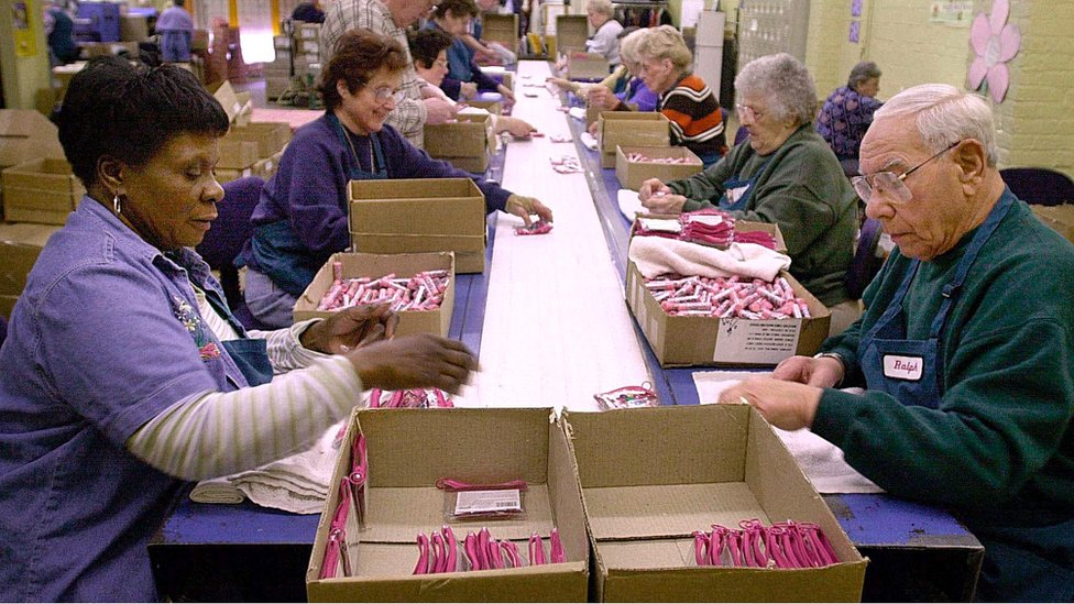 Workers in the senior section package cosmetics on the assembly line at the Bonne Bell cosmetics factory in Lakewood, Ohio, 05, March, 2001