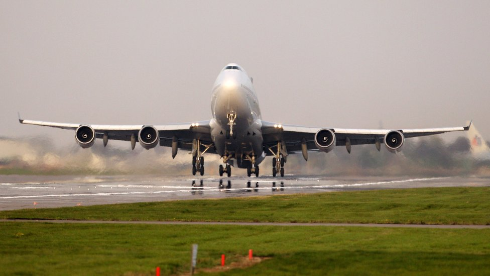 A passenger plane takes off from Heathrow airport