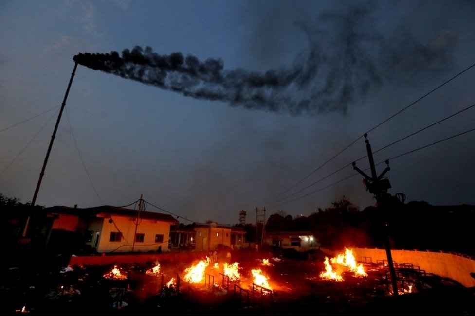 A general view showing burning funeral pyres as relatives perform last rites for covid-19 victims in Bhopal, India, 15 April 2021