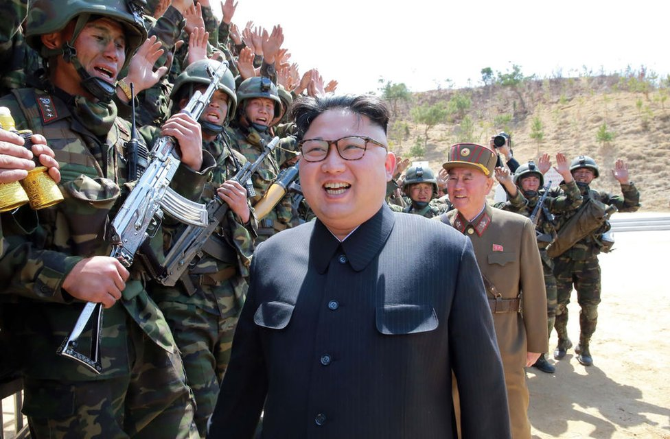 This undated picture released from North Korea's official Korean Central News Agency (KCNA) on April 14, 2017 shows North Korean leader Kim Jong-Un (C) inspecting the 'Dropping and Target-striking Contest of KPA Special Operation Forces - 2017' at an undisclosed location in North Korea.