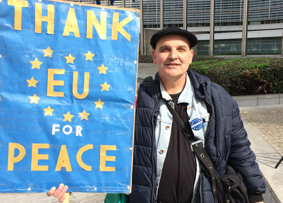 "Demonstrators holds a banner which reads ""Thank EU for peace"""