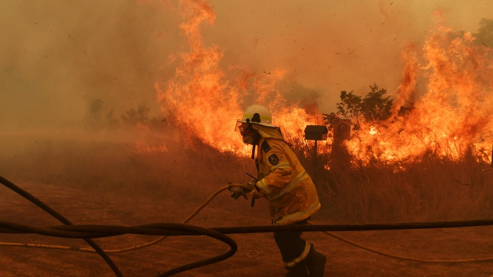A firefighter battles a blaze at Hillside in New South Wales on 13 November