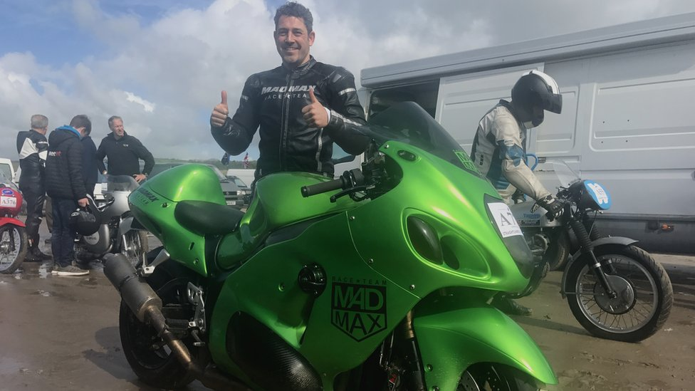 Zef standing behind his bike