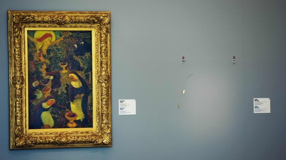 In this file photo taken on October 16, 2012, an empty space is seen where a painting by French artist Henri Matisse was stolen at the Kunsthal museum in Rotterdam, a day after seven masterpieces were stolen in a pre-dawn heist.