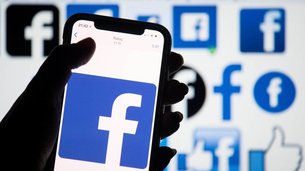 Facebook logo on smartphone screen