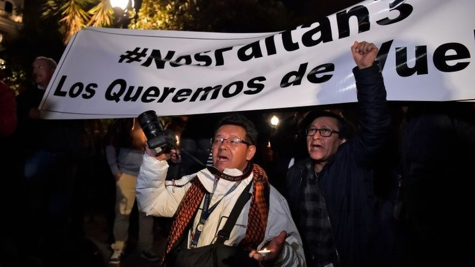 Relatives and colleagues of two journalists and a driver who were abducted on the border with Colombia, demonstrate during a vigil at the Independence square in Quito on March 27, 2018.