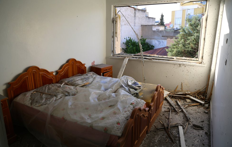 Rubble in a room hit by rocket in Turkish town of Kilis