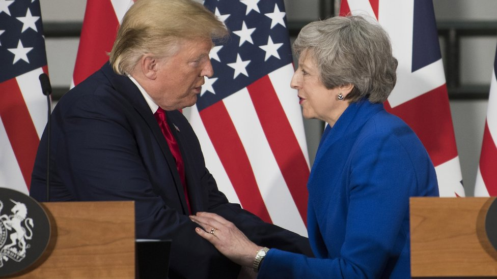 Donald Trump and Theresa May shake hands during a joint press conference