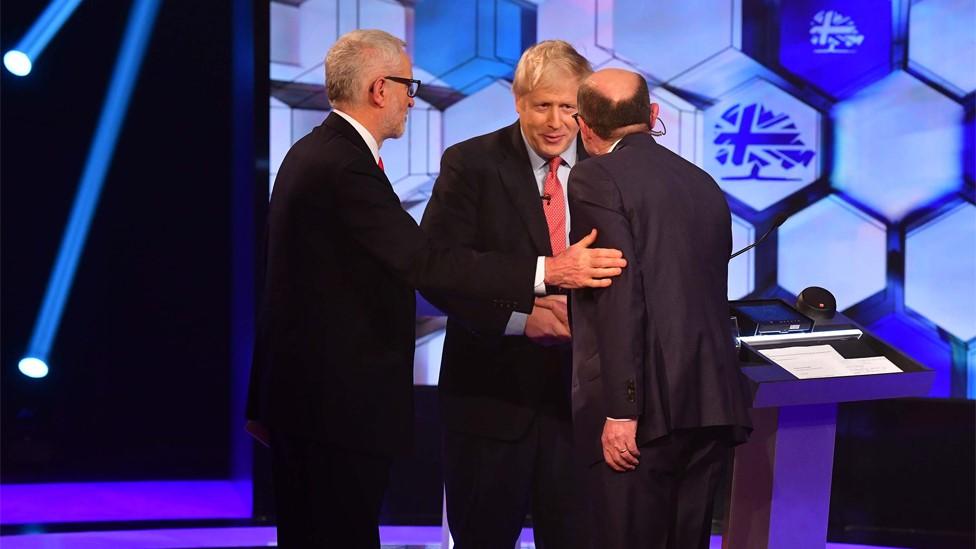 Jeremy Corbyn, Boris Johnson and moderator Nick Robinson