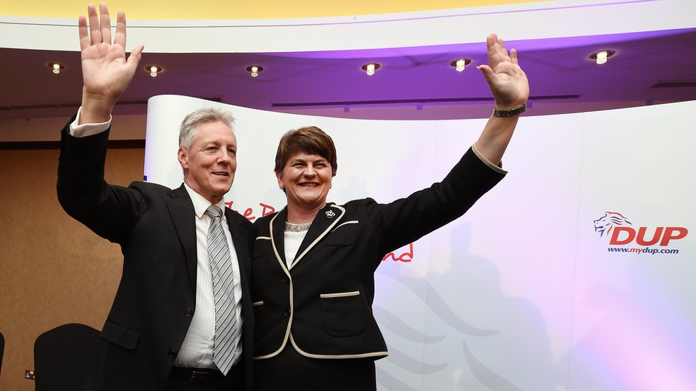 Peter Robinson and Arlene Foster accepts the applause after her speech at the DUP conference in 2015