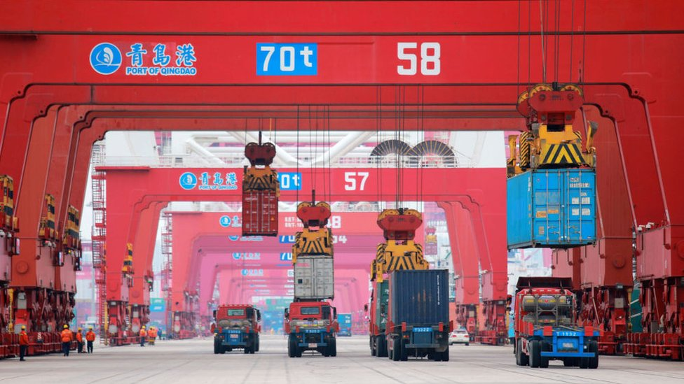 Containers are unloaded at Qingdao Port