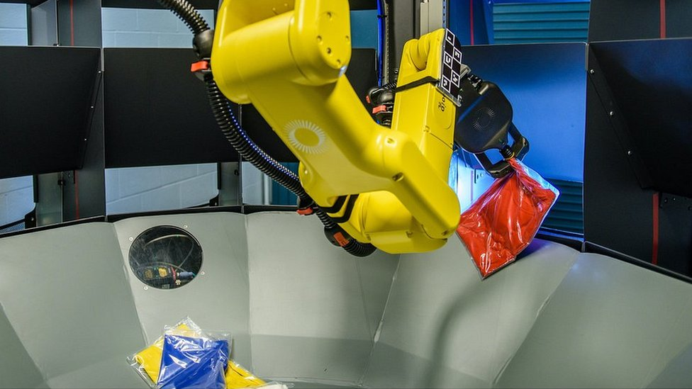 A Kindred system robot sorting clothes