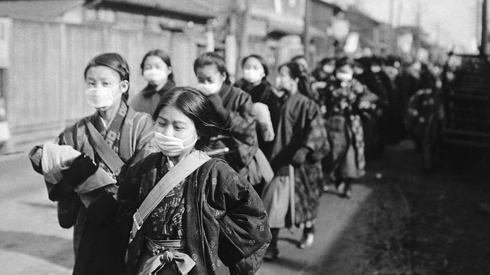 Japanese girls wearing face masks on the way to school in 1920