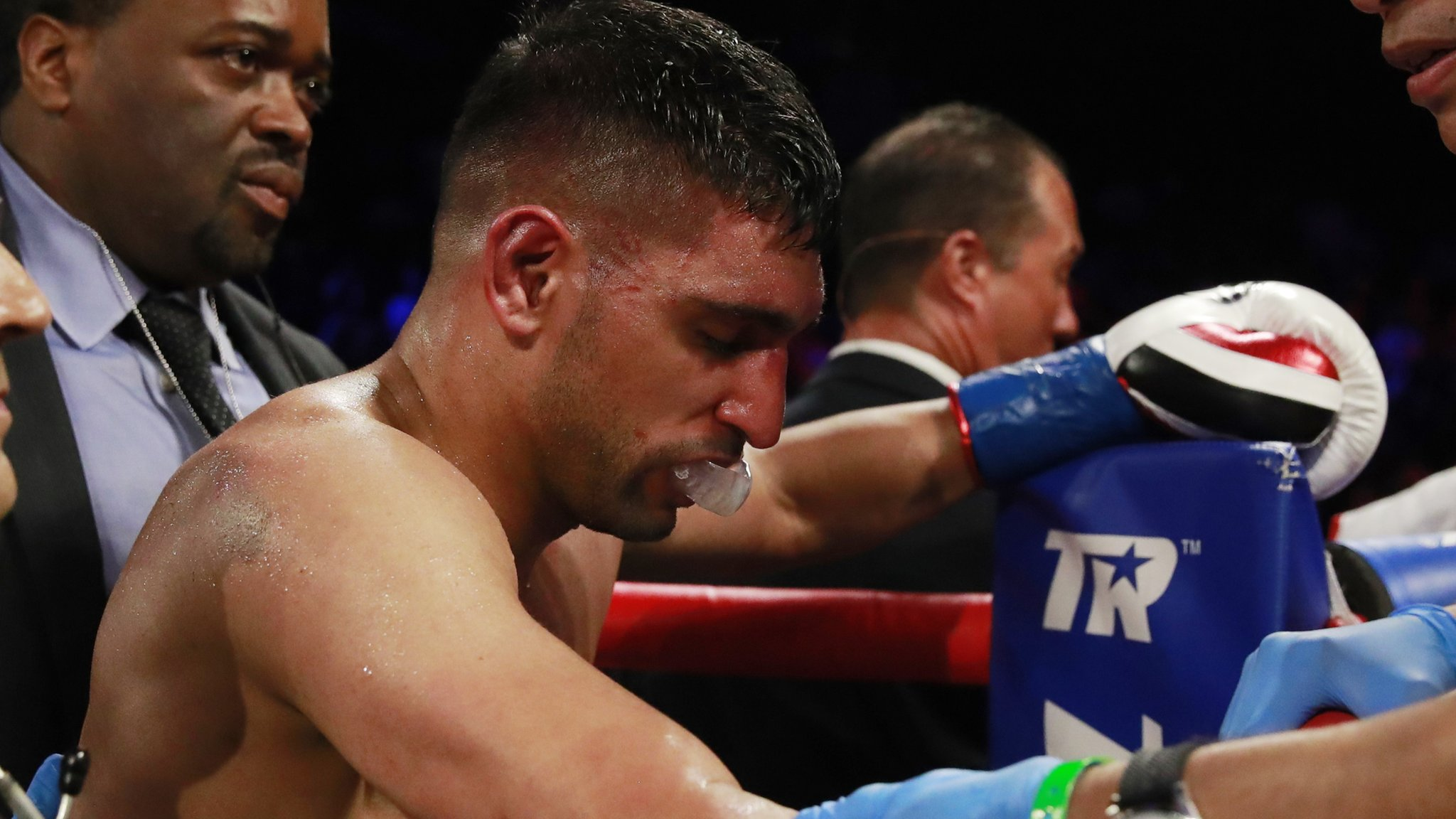 Amir Khan beaten by Terence Crawford following controversial low blow
