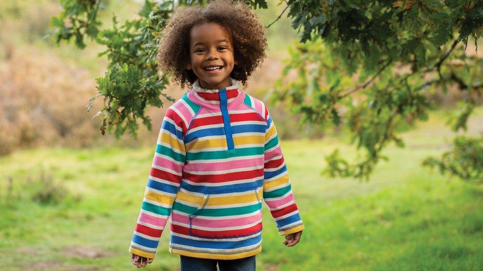 A child wearing Frugi clothing