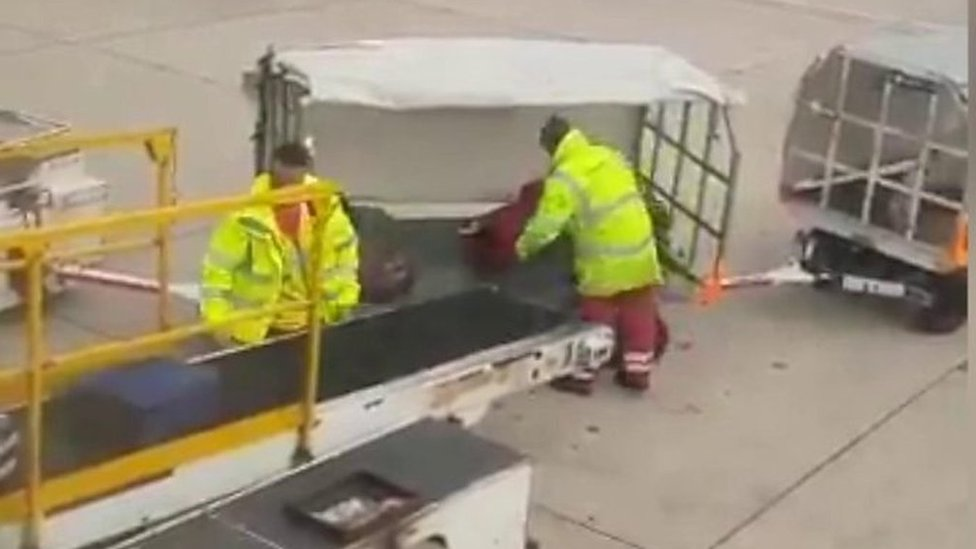 Manchester Airport baggage handler filmed lobbing luggage