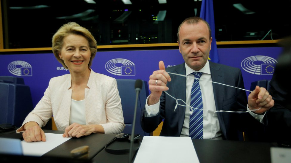 Ursula von der Leyen, who has been nominated as European Commission President, sits next to EU Parliament's political group European People's Party (EPP) president Manfred Weber at the European Parliament