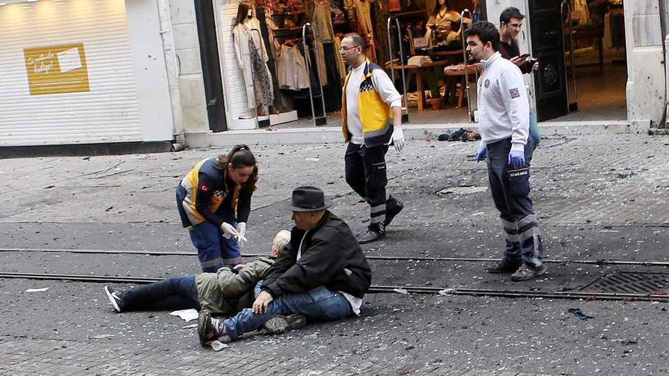 Medics try to help wounded people after an explosion in Istiklal Street in Istanbul