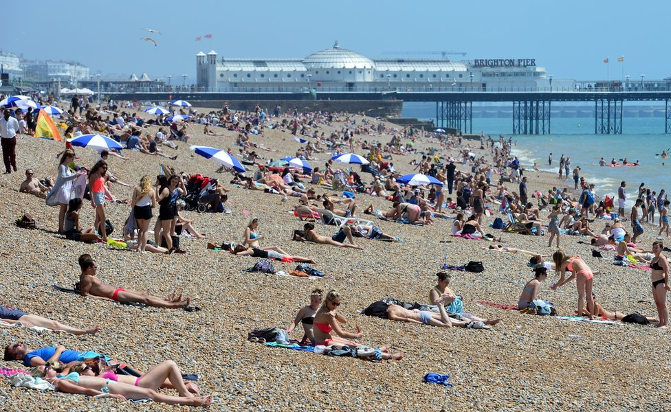 People on the beach in Brighton