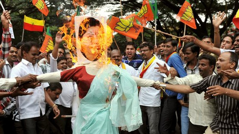 Indian activists from a Pro-Kannada organisation carry a burning effigy of Tamil Nadu Chief Minister J. Jayalalithaa during a protest in Bangalore on 6 October 2012