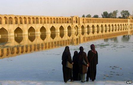 Iranian women look at the Si-o-Se Pol bridge in Isfahan, Iran (13 July 2002).