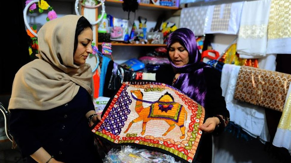 An Afghan shop with a buyer and seller