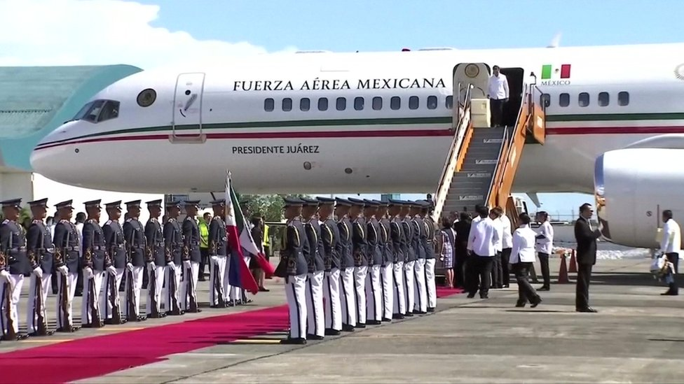 Mexico's President-elect Andrés Manuel López Obrador departs the commercial plane on Wednesday
