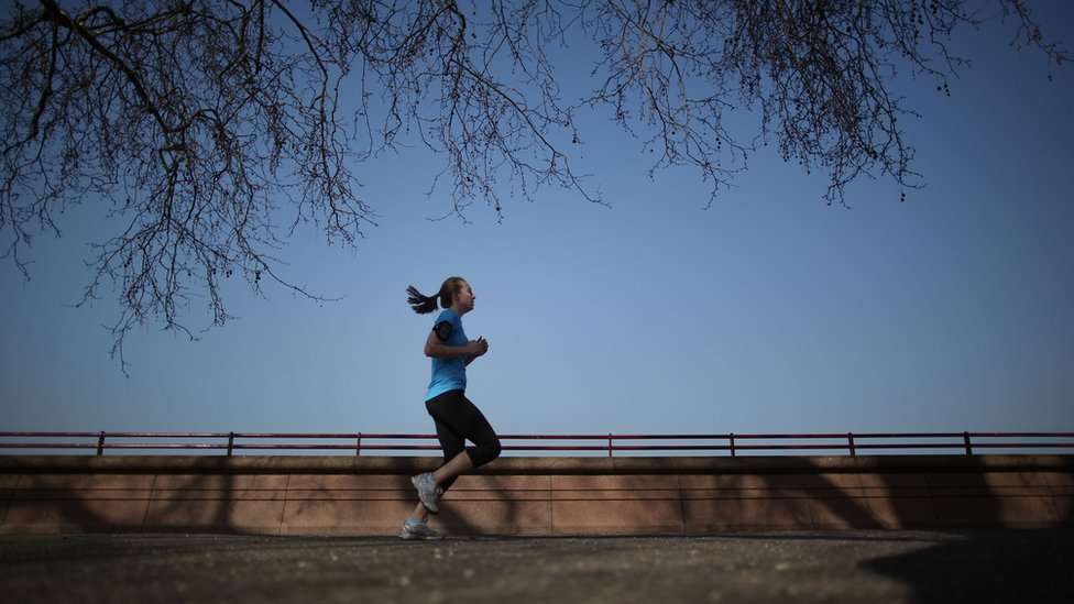 Stock photo of woman jogging in London