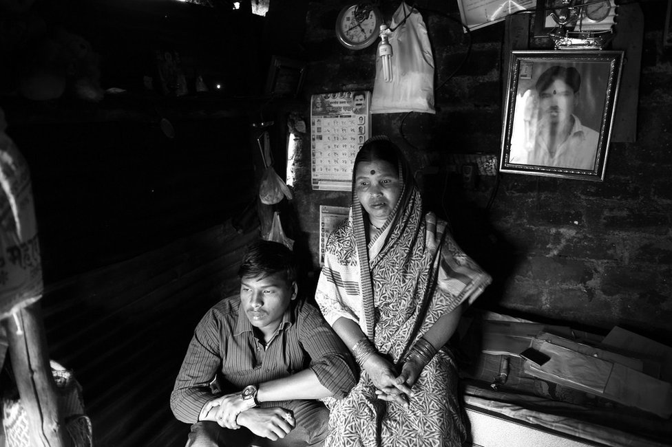 Manik Udage's brother, Shravan, and his mother at their home
