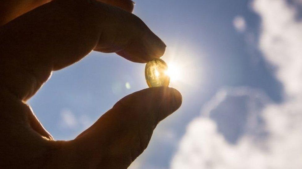 Cápsula de vitamina contra o sol