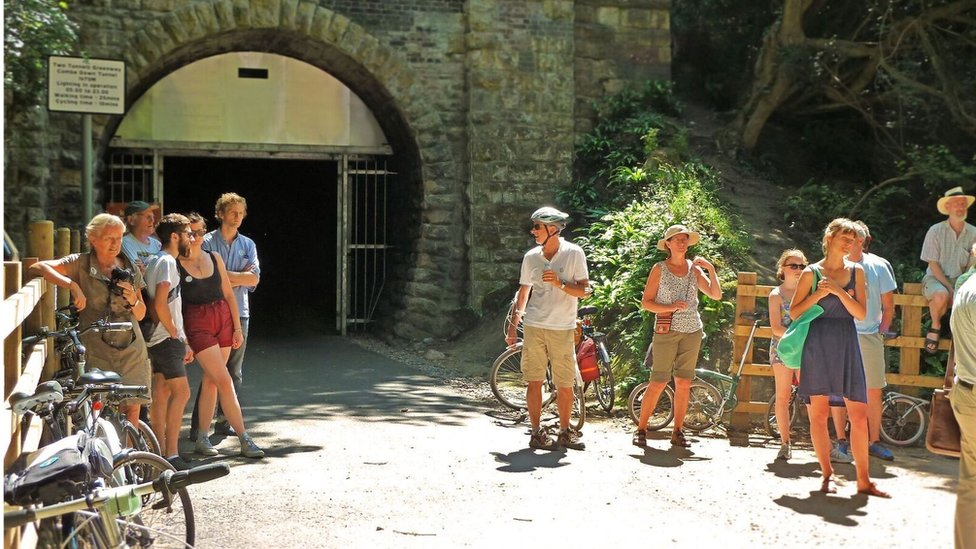 Cyclists at the opening of the Combe Down tunnel