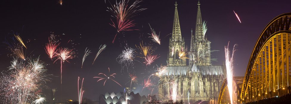 Fireworks explode near Cologne Cathedral (1 Jan)